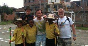 Gary posing for photo with columbian children