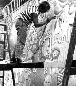 Image of Gary as a young man working on wall mural