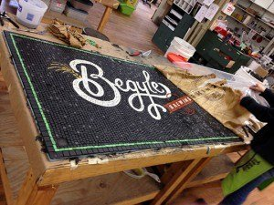 Completed begyles mosaic on bench