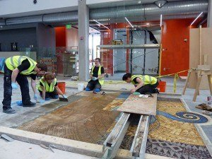 Gary working with his colleagues laying mosaics