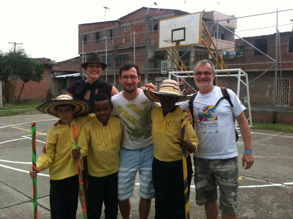 Gary posing for photo with columbian children
