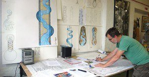 Gary working on drawings and mosaic plans