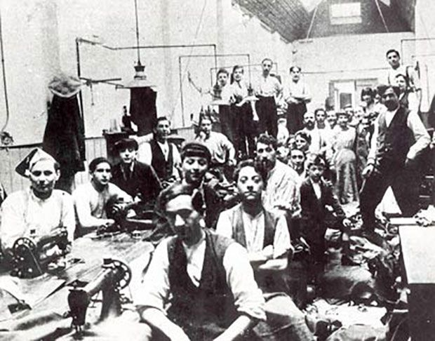 Old image of men working in sewing factory