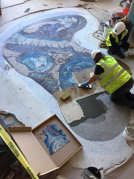 Gary and the installation team fixing the Seagull panel mosaic