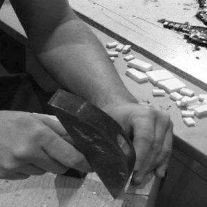 Cutting mosaic glass with a hammer