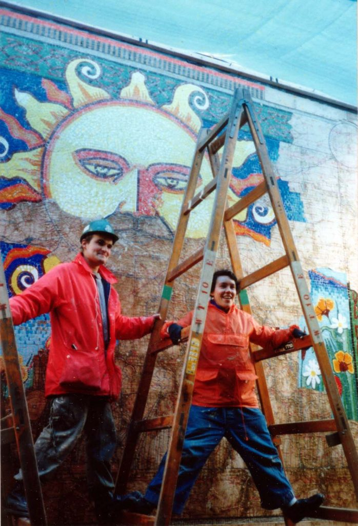 Artists Gary Droste & Ruth Priestly installing Sun mosaic