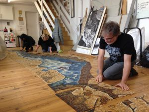 Laying out LPCH mosaic in the studio